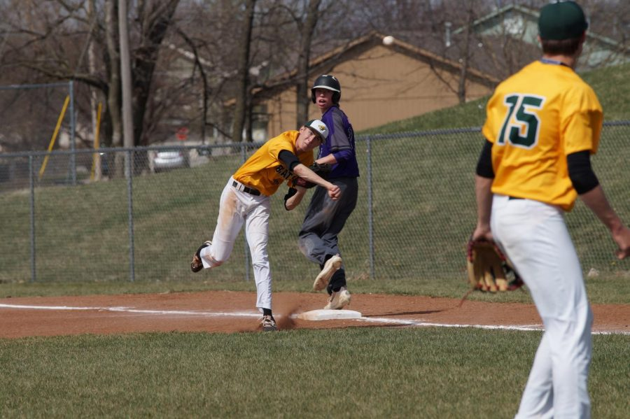 Sophomore Brendyn Bard  looks back at the game after getting an out against Basehor, April 11