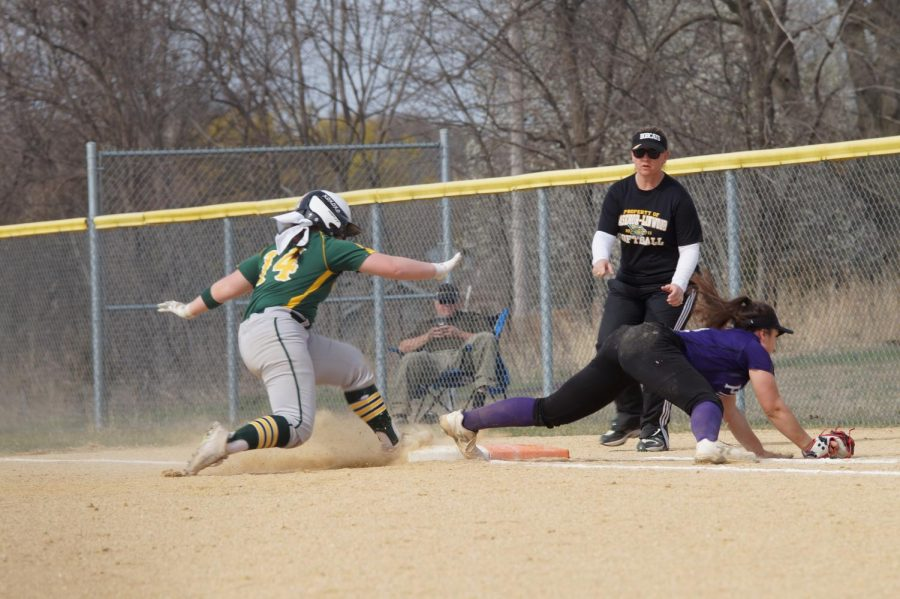 Sophomore Lauren Pappert catches an outside ball in order to get the Basehor player on first out.