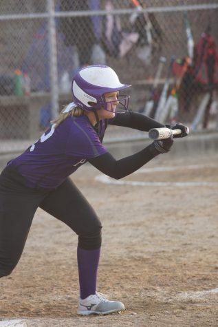 Sophomore Emma Martin takes her stance to bunt on April 5