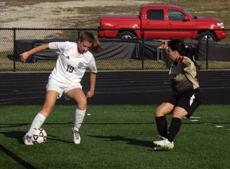 Freshmen Alyssa Gray saves the ball from being out of bounds.