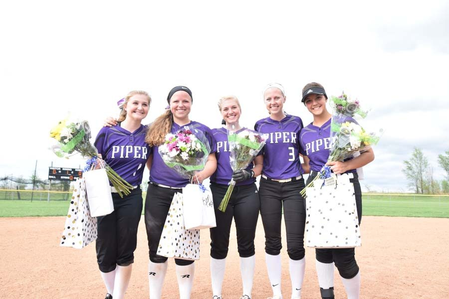 The+2018+softball+seniors+stand+together+at+the+end+of+their+season.