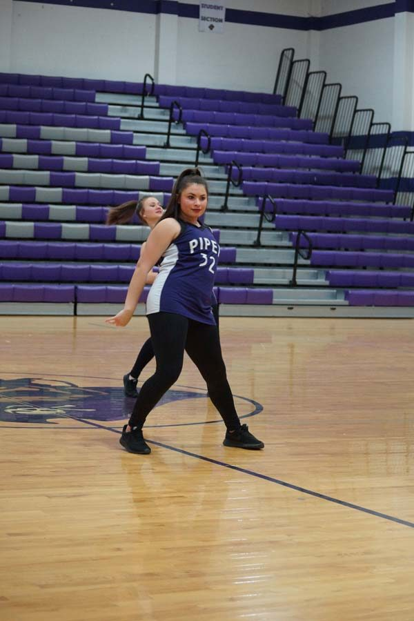 """Junior Taylor McEachron stares at the crowd while performing their hip hop number to """"God's Plan"""" and """"Humble""""."""