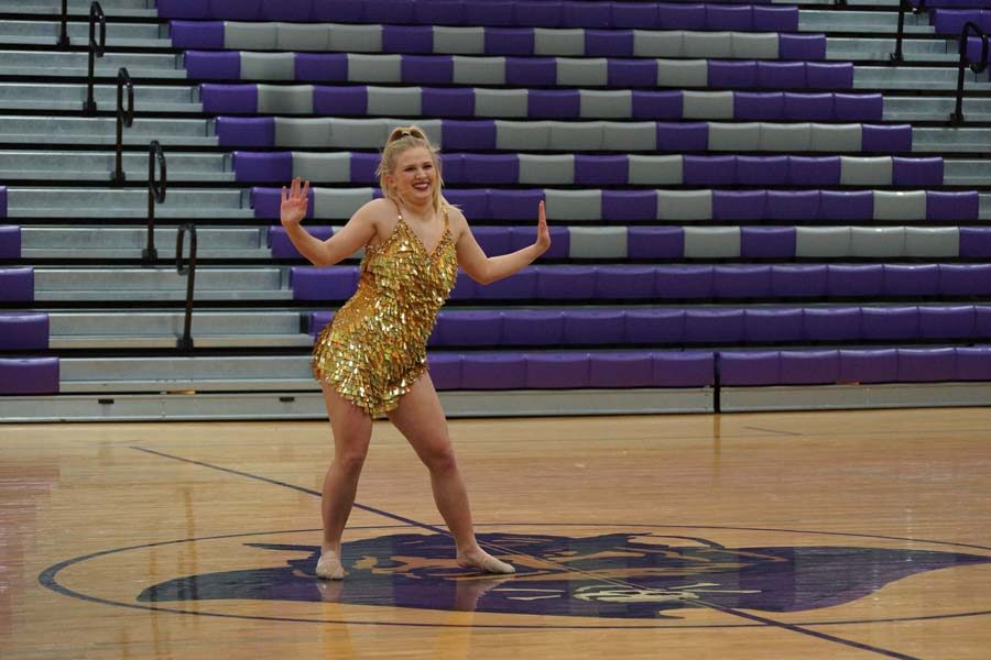 """Junior Calleigh Gardner smiles at the audience as she performs her solo to """"I'm a Good Girl""""."""
