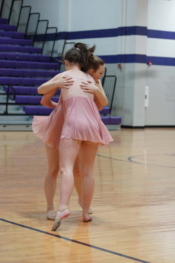 Sophomore Morgan Haworth hugs senior Aubree Knetter during their final dance.