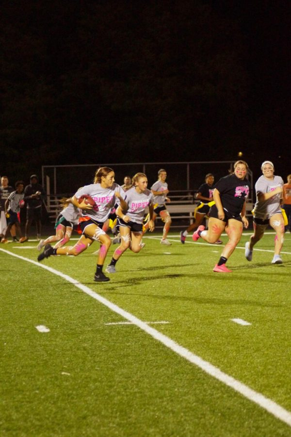Sophomore Evelyn Vasquez runs the ball while junior Riley Porter defends her.