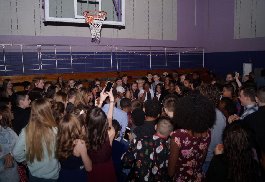 Group of kids gather to watch a dance battle. Jillian Collier won the battle with her exciting moves.