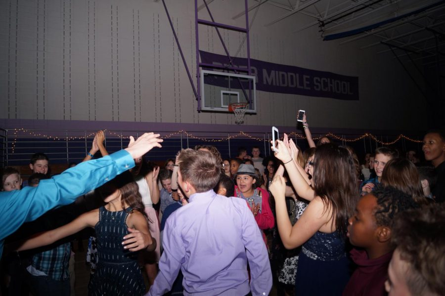 Students celebrate the win of their classmates. It was Quentin and Justine's first win.