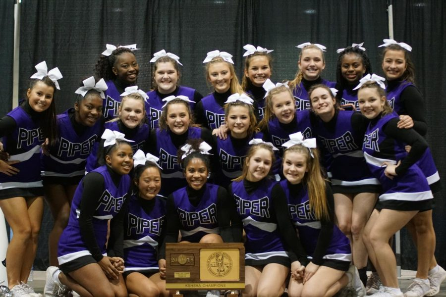 Cheer+team+celebrates+State+Game+Day+Competition+win+with+trophy.