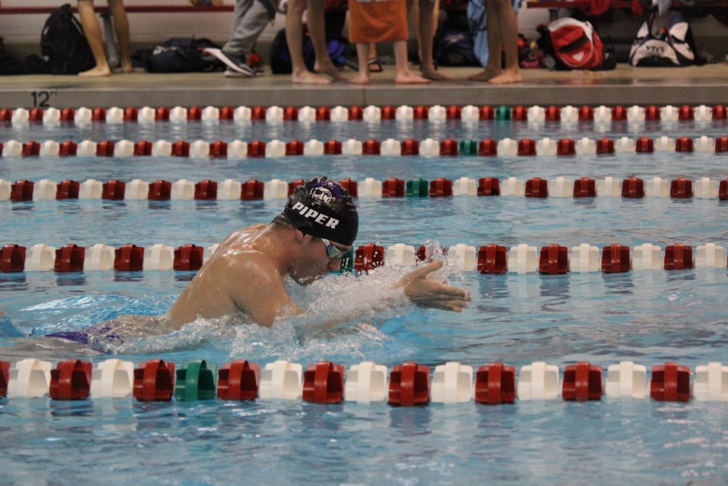 Senior Benjamin Rehm competes in the breaststroke at Blue Valley West. Rehm won first in this race.