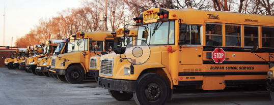 Buses line the parking lot at the district office when they're not taking students to school, home or sports.
