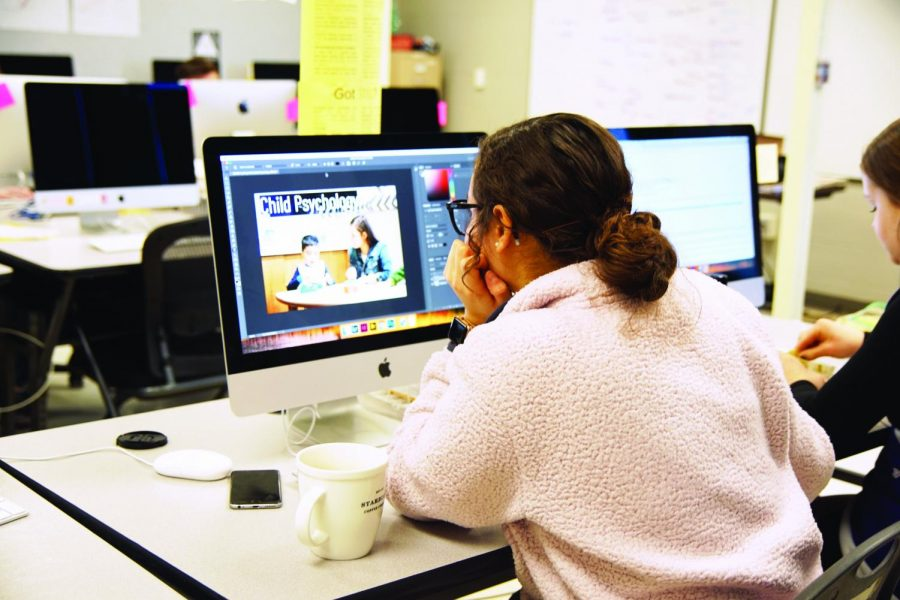 Senior Marisa Sanchez works to create her senior poster about her project on child psychology Dec. 11.