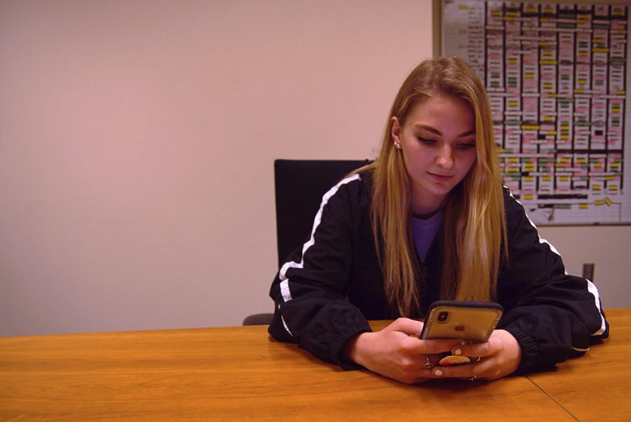 Senior Taran Kerst scrolls through social media during her down time at school.
