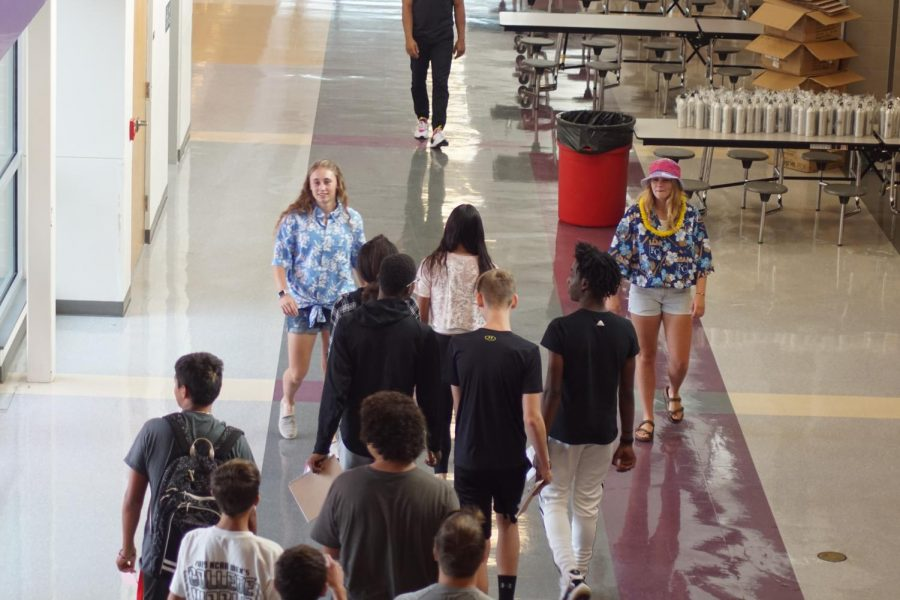 Senior Riley Porter and Sophomore Zoey Pudenz lead freshmen on a tour around a school.  Student Council gave tours of the school to the incoming freshmen on August 12.