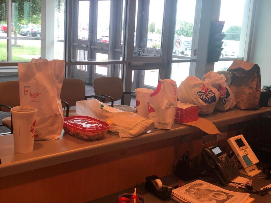 Multiple Doordash and other meal deliveries sit waiting for students to pick them up first block Monday, Sept. 9. On average secretary Sarah Barnes reported five to twenty deliveries per day.