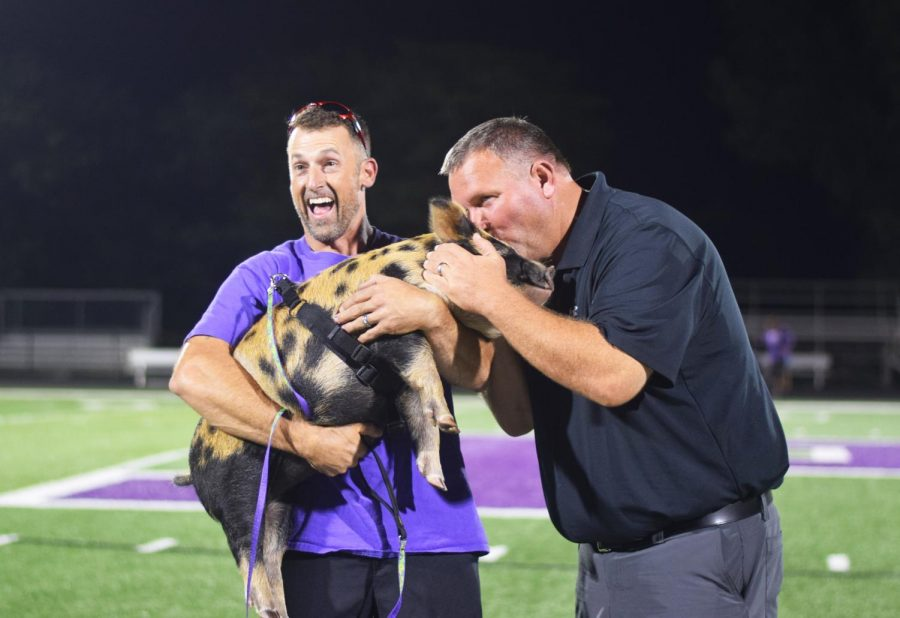 At the end of Powder Puff, football coach Rick Pollard gave Emmett the Pig a smooch. The kiss was inspired by a project Grad fundraiser.