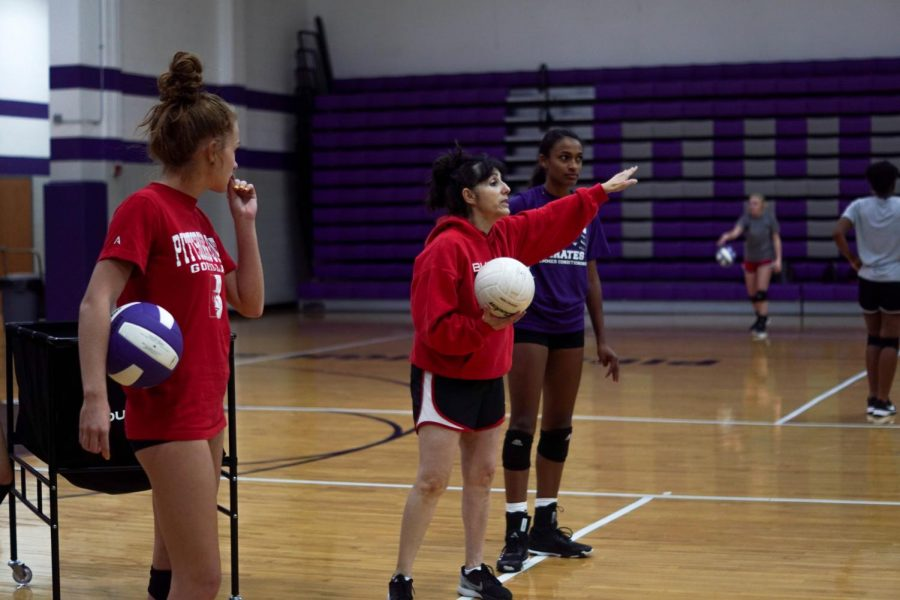 Coach, Rachel Ferguson, introduces a new passing drill at practice Wednesday, Sept. 25. This is Ferguson's first year coaching at Piper.