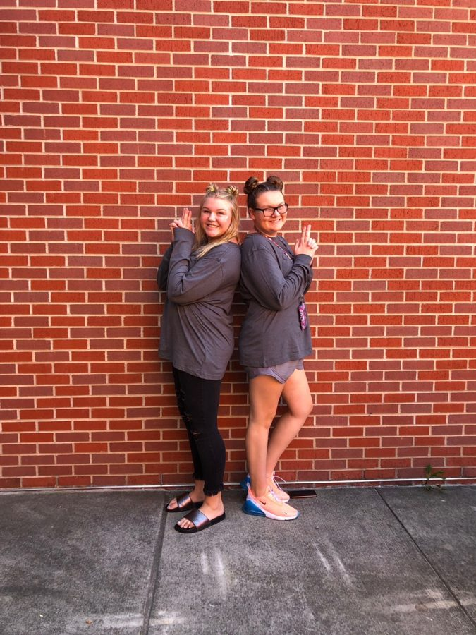 Freshmen Chloe Jochen and Reese Rottinghause wear gray for Galaxy Wars Day.