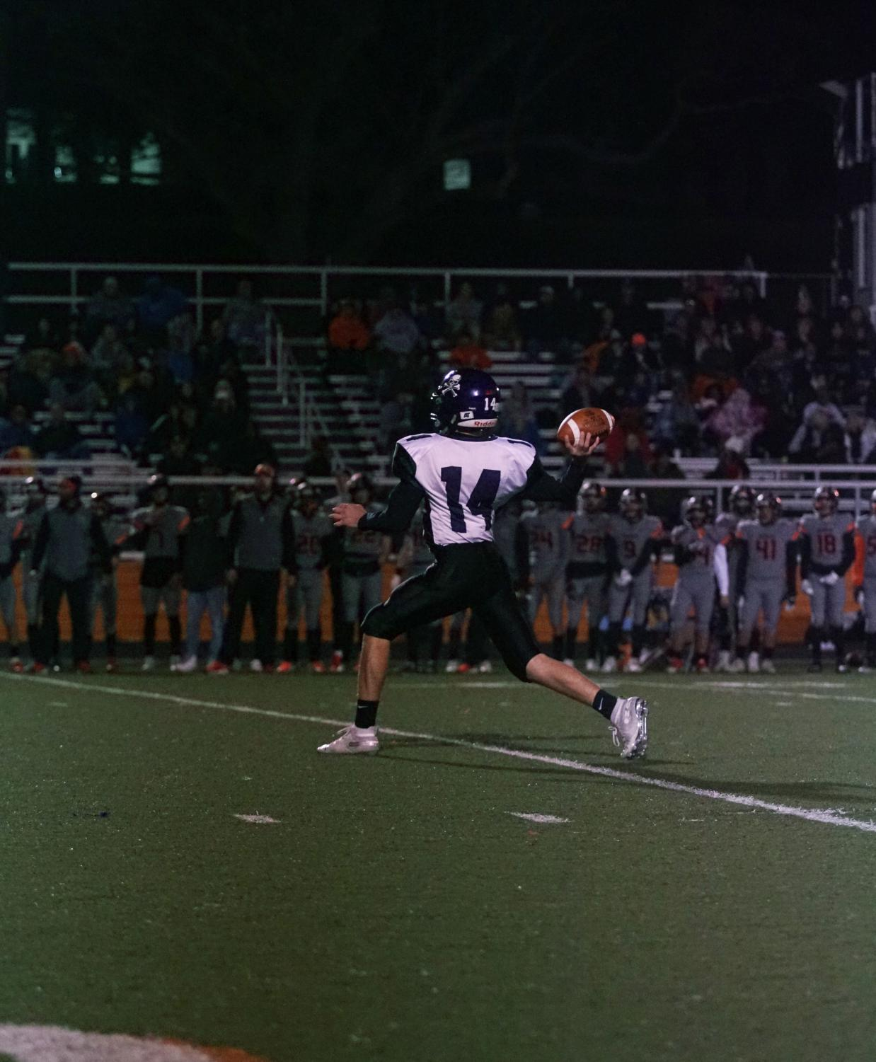 Freshman Logan Ladish throws to an open receiver for a first down in the second quarter.