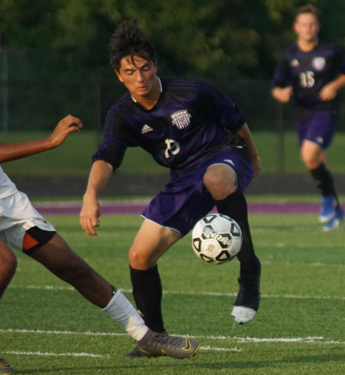 Junior Kyron Fergus dribbles through defenders against Shawnee Mission North on September 3. The Pirates went on to lose the game.
