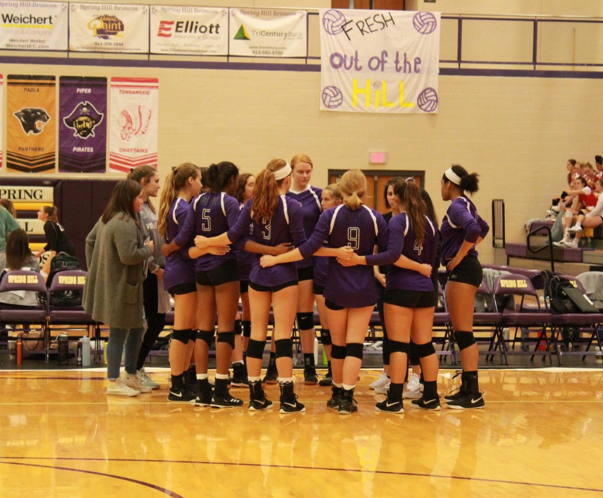 The team huddles together before their game at the Spring Hill tournament on Oct. 5. The team agrees that this has brought them closer together.