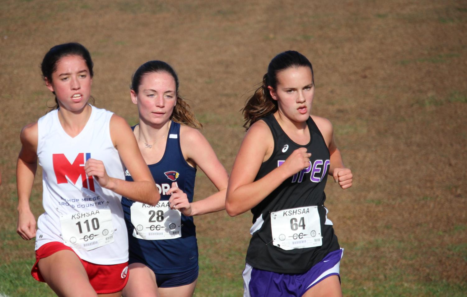 Freshman Grace Hanson moves towards the front of the pack in the regional race. Hanson went on to place second at the state race in Wamego.