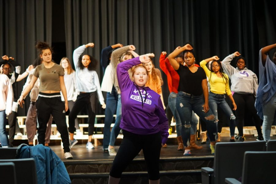 Sophomore Maddie Lamb teaches choreography to cast at musical practice.