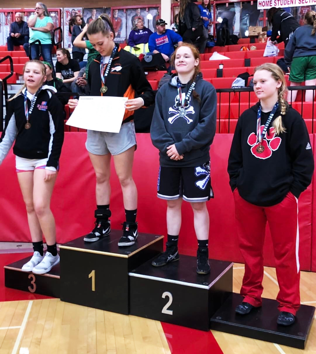 Junior Sara Lake takes her spot on the podium for second place at the Kansas High School Girls Wrestling State Championship