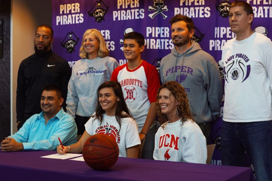 Senior Alison Vigil's family and coach her join her as she signs her letter of intent. Vigil will be a part of the Jenny's basketball team in 2020.