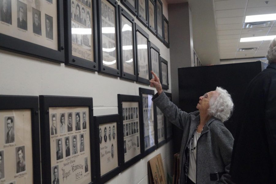 Alumni Marge Scott-Englehart looks at her class pictures and points out her former classmates.