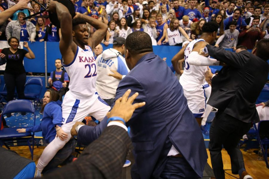 Kansas+player+Silvio+De+Sousa+prepares+to+swing+a+chair+during+the+fight+before+he+dropped+it+on+the+ground.