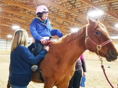 Horse SouixZQ provides support to student Savannah Adams during her lesson. Photo courtesy Mary Sharp
