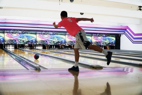 Junior Kyron Fergus aims for a strike at practice.