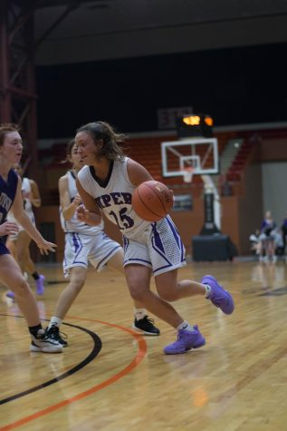 "Senior Grace Banes drops 20 points against Baldwin in the first round of State. ""It felt really good to come out in the first game of state my senior year shooting the ball well, but I couldn"