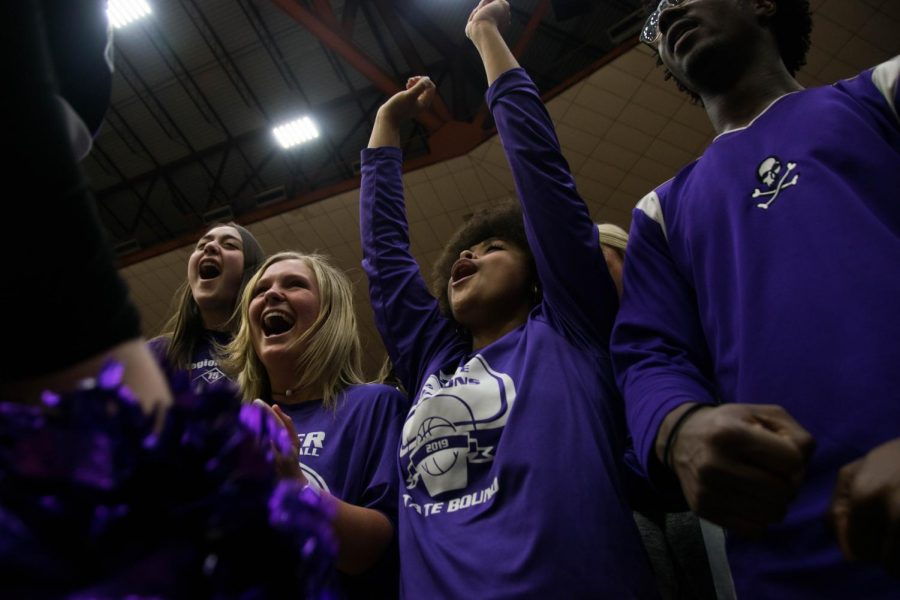 Seniors Emma Martin and Kaylin Miller chant with the Pirates' cheerleaders during a time out at the 4a State Basketball Tournament on March 12. Miller will cherish the memories she has made on the sidelines.