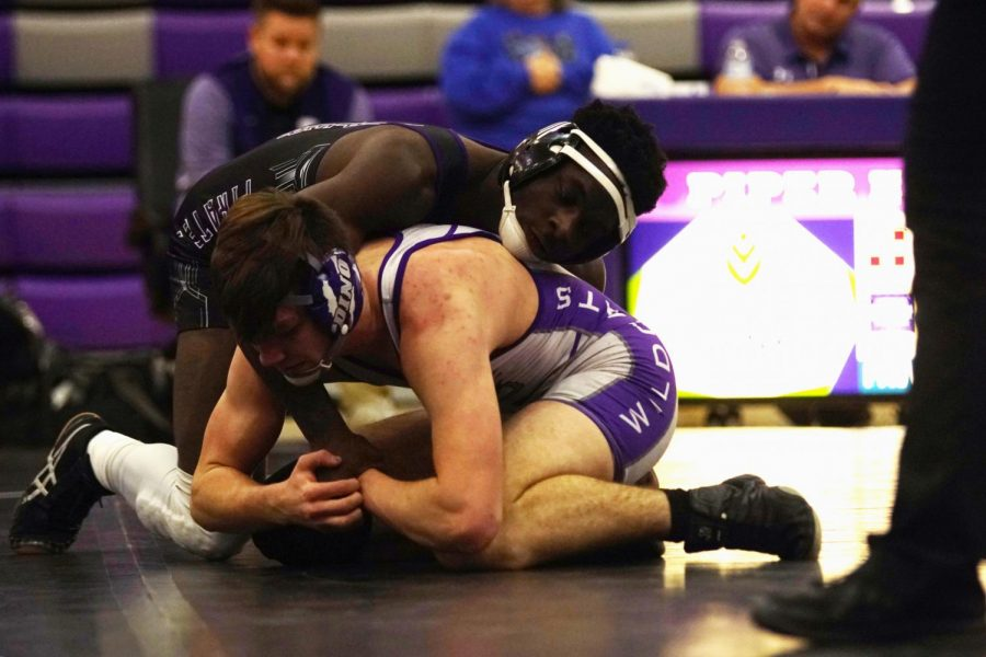 Junior Anthony Fergus is on top of his Louisburg opponent on January 20. Ferguson finished the season 40-1 as the 160 lb state champion.