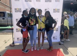 Seniors Taylor Sims, Amari Lynch, Jennifer Guilbeaux, and Jenelle Guilbeaux attend a Black Businesses Matter event in August during National Black Business month.