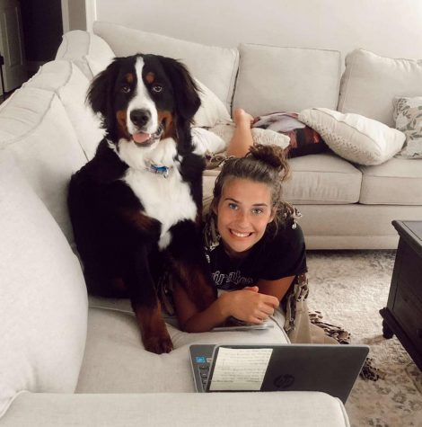 Sophomore Addie Williams completes her schoolwork with her dog Oakley by her side.