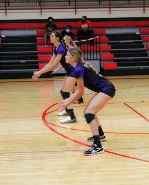 Junior Raven Corlee gets ready to set against Tonganoxie.