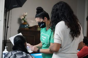 Ashely Adornante, Outreach Coordinator and BMI screener reads results off to a participant.