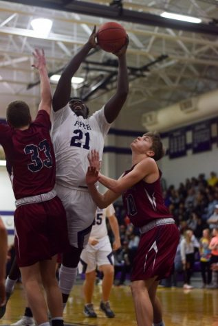 Sophomore Lance Bassett goes up for a layup against Eudora last season.