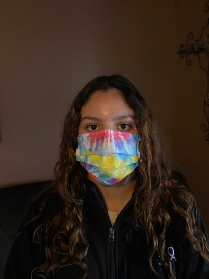 Student+April+Gildo+wears+one+of+her+many+masks+which+have+become+a+vital+accessory.++
