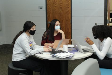 Sophomores Jackie Gildo, Annalia Escalante, and Deanna Jones converse during newspaper stay late night.