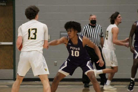 Junior Jaron Briggs locking up on defense against the Bobcats.
