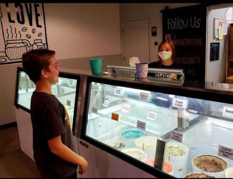 Senior Kaycee Scott works a night shift at Daylight Donuts after school.